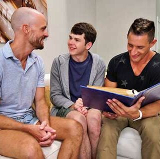 Young twink Dakota Lovell is watching TV with his stepdad Jax Thirio and his stepuncle Jake Lawrence but they can't find anything good to watch so instead they go over their childhood photo album.